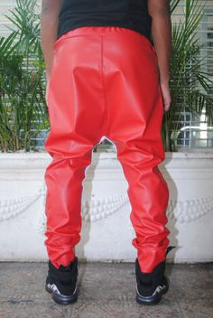 """Red faux leather drop crotch joggers with with cotton detail *** ITEM TAKES UP TO THREE BUSINESS WEEKS TO PRODUCE. **** ****ONE WEEK RUSHED PRODUCTION AVAILABLE FOR $30**** (PLEASE ADD OUR """"RUSHED PRODUCTION"""" LISTING TO YOUR CART) Faux leather and cotton lycra mix with a black"""