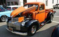 1946 Chevy Pickup Truck Orange & Black with Custom Wheels.