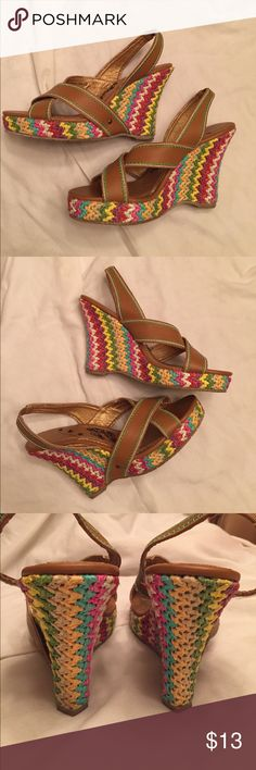 Multicolored espadrille wedges by naughty monkey Multi colored wedges by naughty monkey size 10 in very gently used condition. The shoes have a 4 1/2 inch heel, but wear like a 3 1/2 inch heel as the 1 inch wedge offsets total height by 1 inch. These  shoes are so versatile they can go with almost any outfit,  look at all those colors! These go well with dresses AND they look awesome with jeans TOO! naughty monkey Shoes Wedges