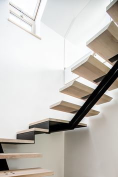 Central stringer stairs by studiodemateria.com
