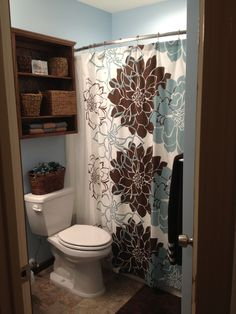 Small bathroom remodel.  Gerber Brianne pedestal sink and Gerber avalanche toilet. Kohler tub and shower. Shower curtain from JCPenneys. Mirror from Home Depot. Baskets from Hobby Lobby. Custom shelving.