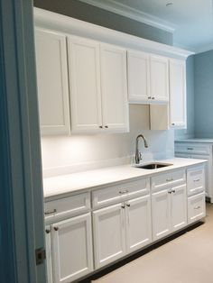 Village Cupboards for Oxbridge Homes. A laundry room with plenty of counter space!