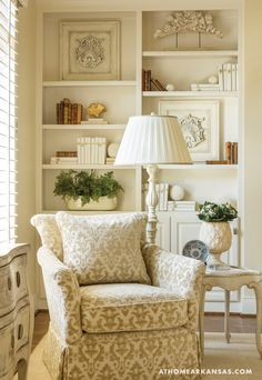 A Century Furniture chair upholstered in a cut-velvet fabric by Beacon Hill coordinates beautifully with fragments from Reborn Relics, which adorn the bookcases.