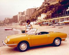 """Fiat 850 Spider 1968.  This was my first car, same color but a 1969 model.  The engine was 817cc, less than 50 cu in.  Easiest car to work on - you could gap the points by turning the flywheel by hand.  I still have the shop manual.  My dad said FIAT stood for """"fix it again, Tony"""""""