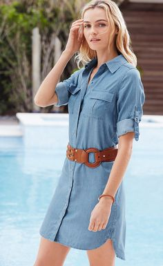 The traditional tunic gets a modern update, thanks to this chambray design with utilitarian roll-tab sleeves. Wear this style with distressed denim jeans and our denim d'Orsay heels.   White House Black Market