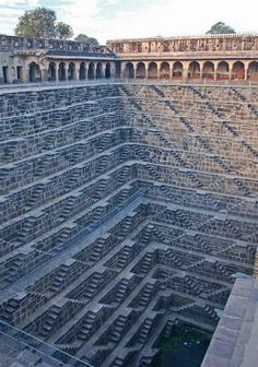 Chand Baori Rajsthan India: Fine example of the architectural excellence.  Chand Baori is a famous stepwell situated in the village of Abhaneri near Jaipur in the Indian state of Rajasthan.  This step well is located opposite Harshat Mata Temple, constructed in 800 c. and is one of the deepest and largest step wells in India. It was built in the 9th century and has 3500 narrow steps in 13 stories and is 100 feet deep.