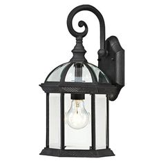 Illuminate your patio or three-season porch in chic style with this eye-catching wall lantern, featuring a gazebo-inspired design and black finish.   ...