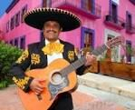 Photo about Charro Mariachi singer playing guitar in Mexico houses background. Image of humorous, macho, crazy - 19163330 Mexican Mariachi, Mexican Hat, Mexican Humor, Destination Soleil, Maya, Holidays In May, Spanish People, Guatemala, Mexico House