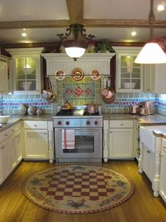 Susan's Miniatures.  I would have this kitchen for my real house!  Just lovely :)
