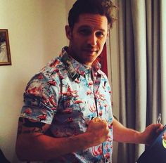 Only Tom Hardy could wear a flamingo shirt and still look sexy.