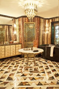 Amazing tile and glass patterns in this stylish bathroom Kelly Wearstler Residential. Visit Design Inspirations: http://inspirations.caesarstone.com/