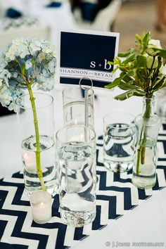 navy chevron runner & vases full of white flowers with lots of votive candles.I'd switch with Coral flowers Wedding Bride, Our Wedding, Wedding Flowers, Dream Wedding, Wedding Ideas, Wedding Tables, Wedding Stuff, Wedding Coordinator, Wedding Planner