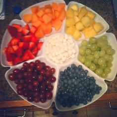 Rainbow fruit tray with marshmallows (clouds). #partyfood