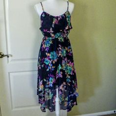 Bold floral hi lo dress Beautiful bright floral printed navy chiffon hi lo dress. Long ruffle at bust gives it a flowy peasant loom. Adjustable straps. Lined. Like new.  30% off in a bundle. No trades. Arizona Jean Company Dresses