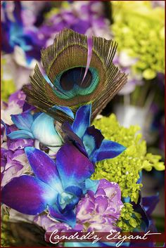 I typically do not like dyed flowers at all but I do like the teal/blue orchids shown here...the color is magical. What do you think?