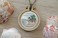 Hand Embroidered Pendant - Beach Ocean Palm Tree Landscape - Mini Embroidery Hoop Necklace by IttyBittyBunnies on Etsy https://www.etsy.com/listing/462702046/hand-embroidered-pendant-beach-ocean
