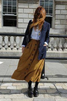 That's a Wrap — Over 100 Street-Chic LFW Snaps to See Now: Windy day aside, we can't help but adore the sweet mix of Fall colors here. Saffron yellow, crisp white, and navy blue make a perfect palette trio.