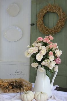 Really like the look of the white pitcher as the flower vase!   Vintage Door to Shabby Chic Decor