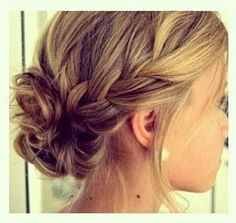 I really like the loose braid and how the bun is low and to the side