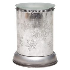 A glorious addition to our new Lampshade Collection, Silver Frost captures the elegance of snowflakes on a silvery glass vase. With a flick of the switch, the delicate flakes cast a radiant glow with plays of shadow and light.