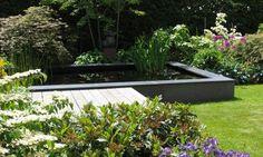 http://www.tuinen-tuinontwerp.nl/groenadvies/beeld/kleine_tuin_met_zithoek_32/