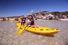Sea Kayaking in Langebaan, West Coast with Gravity Adventures. Sea kayaking and accommodation, just one hour from Cape Town. Explore the clear, blue waters of Langebaan Lagoon – in the centre of the West Coast National Park – by kayak, picnic on the white sand beach or enjoy brunch at a beachfront restaurant. #dirtyboots #langebaan #kayaking #southafrica