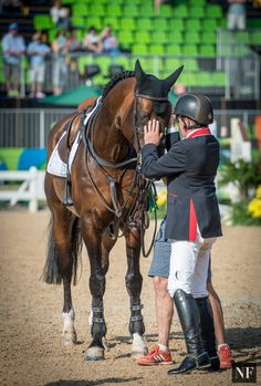 Nick Skelton shares a moment with Big Star before being awarded his first…
