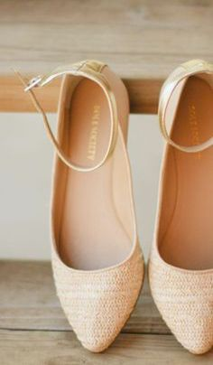 Cute flats with ankle straps in light cream color.