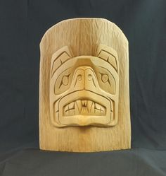 "Grizzly Bear Miniature Totem by Tom Harry, Squamish Nation.  Hand carved from yellow cedar.  Measures 10.5""h x 7.25""w x 3.5""d and weights 0.75lb.   This piece is sold, please considar having a similar piece commissioned by the artist.  Contact us for more details.   Click here to learn more about the Northwest Coast Aboriginal Symbology of the Bear."