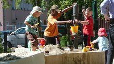adventure playground. kids interact with water