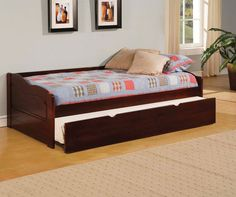 SUNSET DAYBED W/ TWIN TRUNDLE [CM1737]Low profile and comfortable, this classic daybed features a mattress ready platform bed, twin trundle, slat kit and is finished in a rich cherry. Sale for $275