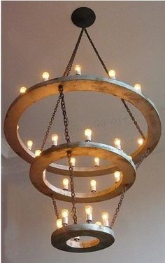 chandelier : this is a halo chandelier that hangs in a Portland hotel apparently. I had a friend who is a finished carpenter and do-it-yourself make one with battery operated twinkle lights and we dropped it from a beam outside with draperies. Loved loved.
