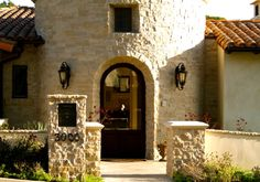 Stone entryway with Spanish entry door.