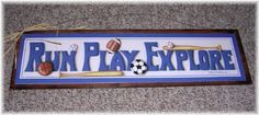 "Run Play Explore Boys Sports Bedroom Wooden Wall Art Sign Football Baseball Soccer Basketball by The Little Store of Home Decor. $13.99. size 6x21. made in the USA. We've sealed this Run Play Explore sports art print onto wood giving it a framed appearance. We've painted the background wood a chocolate brown  color with touches of black to accent the print. It measures approximatley 6"" tall by 21"" wide by 1/4"" thick. We've added a piece of rusty tin wire for easy hanging (..."