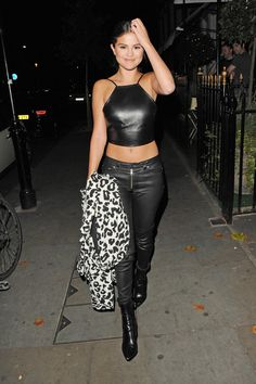 Selena Gomez goes out in London in a head-to-toe leather street style look.