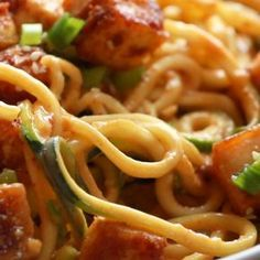 Spicy Sesame Zoodles with Crispy Tofu! SUPER easy recipe with familiar ingredients - soy sauce, peanut butter, sesame oil, garlic, zucchini, and tofu. #vegan #vegetarian #sesame #tofu #zoodles #spiralizer #healthy #glutenfree | pinchofyum.com