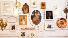 Gallery wall with vintage photography and metallic sculptural objects