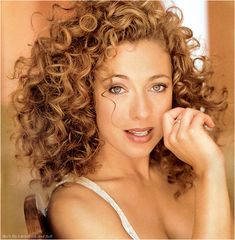 If I was given the choice between assured happiness and hair like Alex Kingston's, I'd really have to think about it. Honestly, they're probably the same thing...especially if I could have her accent as well!