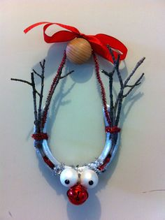 Christmas horse shoe reindeer Cleaned up a horseshoe, and just used pipecleaners, small tree ornaments, sticks, ribbon and hot glue to make this cutie (with the help of a three year old)!