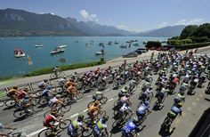 TDF 2013.  The peloton on stage 20 riding beside Lake Annecy.