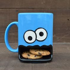Who better to join you for a delicious snack of cookies and milk than the Cookie Monster. The Cookie Monster coffee mug's creative design lets you place a couple of cookies inside his mouth for safekeeping as they wait to be dipped in the milk above. Monster Cup, Cookie Monster, Monster Eyes, Coffee Cups, Tea Cups, Cappuccino Cups, Iced Coffee, Cool Inventions, Calla Lilies