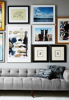a perfectly curated salon wall anchored by a gorgeous grey tufted sofa