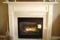 White fireplace mantel makeover - Living Rich on LessLiving Rich on Less