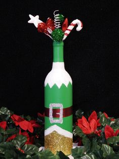 Elf Wine Bottle Christmas Decorations A personal favorite from my Etsy shop https://www.etsy.com/listing/484727838/elf-wine-bottle-christmas-decor