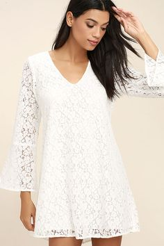The Lucy Love Wild Child White Lace Long Sleeve Dress lets them know you've got a sweet side too! Floral lace shapes this lovely shift dress with a rounded V-neckline, long bell sleeves, and back cutout.