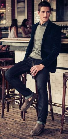 Nice blazer, shirt, pullover, jeans, and mocassins.