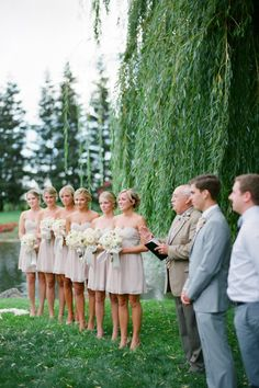 Neutral bridesmaid dresses and wide-ribboned bouquets.
