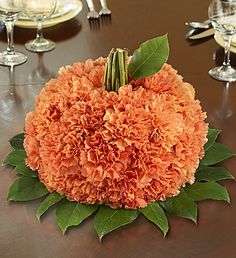 Fresh Flower Pumpkin  This fresh pumpkin-shaped arrangement is our first pick for sending smiles. Filled with bright orange carnations, it's the perfect centerpiece for a truly original Halloween party, housewarming or fall birthday. Artistically crafted by our floral designers, they'll swear it came straight from the pumpkin patch!
