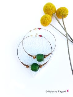 Ethnic chic hoops / large gold steel rings, gypsy style, with african frosted glass beads, from Ghana. © Natacha Fayard§ #ethnic #ethnique #chic #gypsy #bohemian #earrings #rings #hoops #ghana #africa #african #beads #glass #frosted