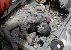 Heartbreaking photograph from the Earthquake disaster in Nepal.  Notice one of the victims is still holding a pen